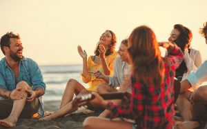 image of friends connecting on the beach