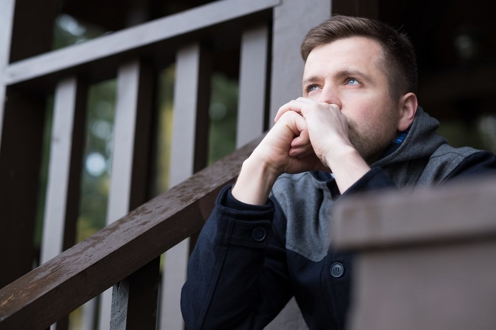 image of man thinking about hating life