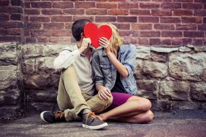 """image of man and woman to respresent someone wondering, """"Am I in love?"""""""